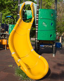 Yellow children's slide. Close-up of an yellow childrens slide, part of a children playground stock photos