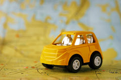 Yellow children's car on map background Stock Photography