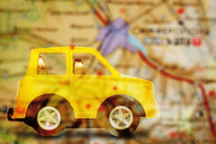 Yellow children& x27;s car on map background Stock Photos