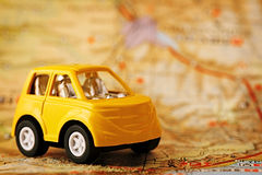 Yellow children& x27;s car on map background Stock Photography