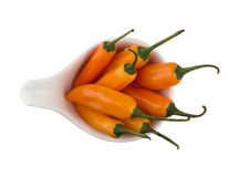 Yellow chili pepper in white bowl Stock Photography