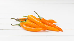 Yellow chili pepper on white table background Royalty Free Stock Photo