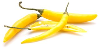 Chilli Pepper. Yellow Chili peppers, two whole and one sliced, two halves, isolated on white backgroundn stock photos