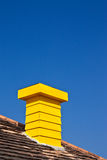Yellow chimney and blue sky Stock Photos