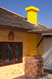 Yellow chimney and blue sky Royalty Free Stock Photography