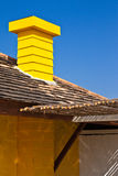 Yellow chimney and blue sky Stock Photography