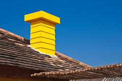 Yellow chimney and blue sky Royalty Free Stock Images