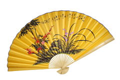 Yellow Chinese fan. (isolated) Stock Photography