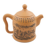 Yellow chinese teapot with drawing and ornament Stock Photography