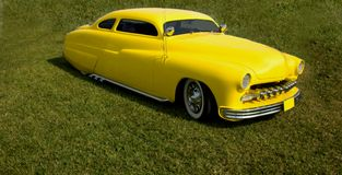 Yellow chopped hotrod. Retro, classic yellow chopped hotrod on grass Royalty Free Stock Photo