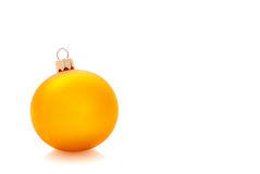 Yellow christmas ball isolated, place for text Royalty Free Stock Photos