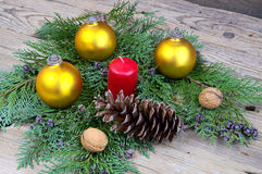 Yellow Christmas balls with red candle with cone and walnuts Stock Photo