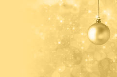 Yellow Christmas Bauble on Starry Bokeh Background Royalty Free Stock Photo