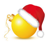 Yellow Christmas baubles with Santa Claus Hat. Golden Christmas ball, Christmas ball , santa claus hat, red hat, red cap,   fir twigs, christmas ornament, white Royalty Free Stock Photo