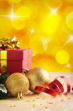 Yellow Christmas decoration with two balls and gift Vertical com Stock Image