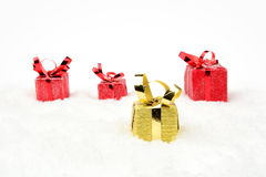 Yellow christmas gift stands out of crowd on snow in line Stock Photos