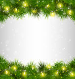 Yellow Christmas lights on pine branches on grayscale Stock Photography