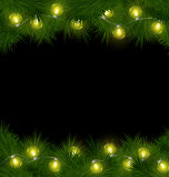 Yellow Christmas lights on pine isolated on black Royalty Free Stock Image