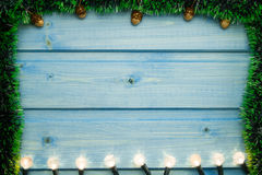 Yellow Christmas lights on wooden background. stock photos