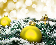 Yellow christmas ornament ball against yellow bokeh background Royalty Free Stock Image