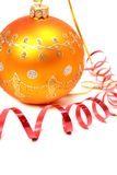 Yellow christmas sphere and red streamer. Yellow christmas sphere and streamer of red color Stock Photography