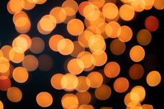 Yellow Christmas Tree Bokeh on black background of defocused glittering lights, Christmas background pattern concept royalty free stock images