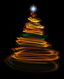 Yellow christmas tree light painting Stock Images