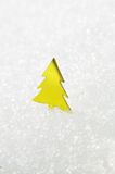 Yellow Christmas tree on snow Stock Photo
