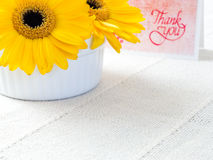 Yellow chrysanthemum flowers with thank you note. Yellow chrysanthemum flowers with handmade thank you note card Royalty Free Stock Photography