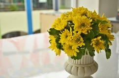 Yellow chrysanthemum flowers in white ceramic vase Stock Image