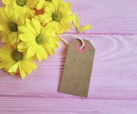 Yellow chrysanthemum on a pink wooden background, mother`s day, tag,  sale. Yellow chrysanthemum on a pink wooden background mother`s day tag Stock Photography