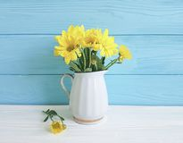 Yellow chrysanthemum vase on white and blue vibrant. Yellow chrysanthemum vase on white and blue wooden  vibrant Stock Photography