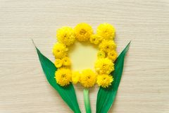 Yellow chrysanthemum on a wooden background, free space royalty free stock images