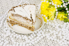Yellow chrysanthemums, piece of cake and beads Stock Photos