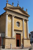Yellow church. Facade in Castelleone, Cremona, Italy Royalty Free Stock Image