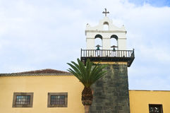 Yellow church and bell tower. With palm tree in Gorachico, tenerife, canary islands Royalty Free Stock Photos