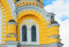 Yellow church building with windows and pillars Royalty Free Stock Photo
