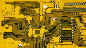 Yellow Circuit Board. Circuit board from an electronic device lite up from behind Stock Photos