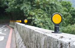Yellow ciricle signs on the road Stock Photo