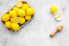 Yellow citrus fruit set with lemons stone background top view mock-up. Yellow citrus fruit set with lemons on stone background top view mock-up Royalty Free Stock Photos