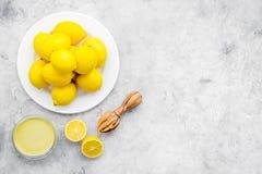 Yellow citrus fruit set with lemons stone background top view mock-up. Yellow citrus fruit set with lemons on stone background top view mock-up Royalty Free Stock Photography