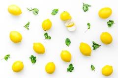 Yellow citrus fruit set with lemons white background top view pattern. Yellow citrus fruit set with lemons on white background top view pattern Stock Photography