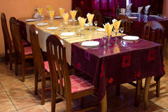 Yellow and claret coloured restaurant table Royalty Free Stock Photo