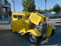 Yellow classic automobile with chrome at car show Stock Photography