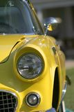 Yellow Classic Car. Close up shot of head lamp of yellow classic car Stock Images