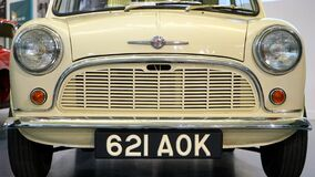 Yellow Classic Car With 621 Aok Licensed Plate Stock Photo