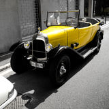 Yellow classic car at Aspettando la Mille Miglia 2016. A yellow classic car from the early 1900 exposed during the 2016 event Aspettando la Mille Miglia in Stock Image