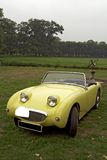 Yellow classic convertible car. Yellow classic austin healey sports car outside royalty free stock photo