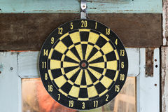 Yellow classic darts board on the old window.  Royalty Free Stock Photo