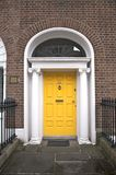 Yellow classic door Stock Photos